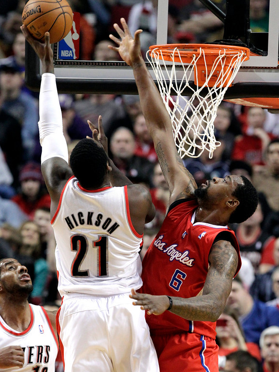 . Portland Trail Blazers center J.J. Hickson, left, shoots against Los Angeles Clippers center DeAndre Jordan during the first quarter of an NBA basketball game in Portland, Ore., Saturday, Jan. 26, 2013.(AP Photo/Don Ryan)
