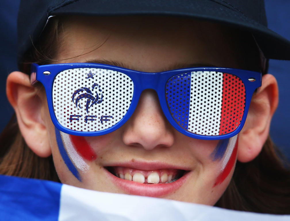 . PORTO ALEGRE, BRAZIL - JUNE 15:  A France fan enjoys the the atmosphere prior to the 2014 FIFA World Cup Brazil Group E match between France and Honduras at Estadio Beira-Rio on June 15, 2014 in Porto Alegre, Brazil.  (Photo by Jeff Gross/Getty Images)