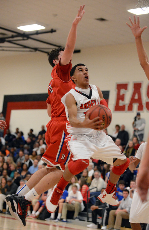 . East\'s Brian Carey goes up for the shot against Cherry Creek\'s defense in the 1st half of the game at East High School on Friday, Nov. 30, 2012. Hyoung Chang, The Denver Post