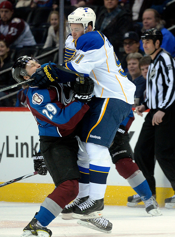. Colorado center Nathan MacKinnon (29) collided with St. Louis right wing Vladimir Tarasenko (91) in the first period. The St. Louis Blues defeated the Colorado Avalanche 2-1 at the Pepsi Center Saturday afternoon, March 8, 2014 in Denver, Colorado. (Photo by Karl Gehring/The Denver Post)