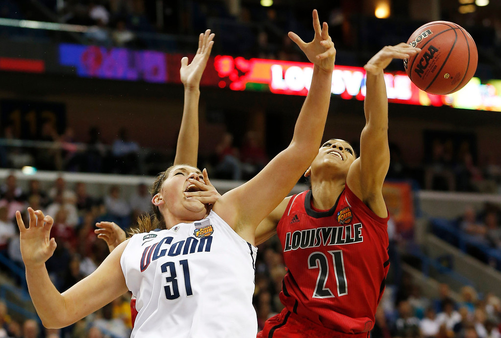 . Louisville guard Bria Smith (21) blocks a shot against Connecticut center Stefanie Dolson (31) during first half of the national championship game of the women\'s Final Four of the NCAA college basketball tournament, Tuesday, April 9, 2013, in New Orleans. (AP Photo/Dave Martin)
