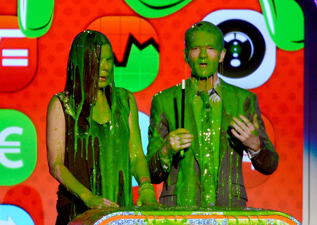 . LOS ANGELES, CA - MARCH 23:  Actors Sandra Bullock and Neil Patrick Harris speak onstage during Nickelodeon\'s 26th Annual Kids\' Choice Awards at USC Galen Center on March 23, 2013 in Los Angeles, California.  (Photo by Kevork Djansezian/Getty Images for KCA)