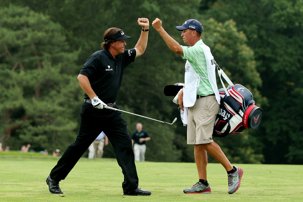 . ARDMORE, PA - JUNE 16:  (L-R) Phil Mickelson of the United States celebrates making a shot for eagle on the tenth hole par 4 with caddie Jim Mackay during the final round of the 113th U.S. Open at Merion Golf Club on June 16, 2013 in Ardmore, Pennsylvania.  (Photo by Andrew Redington/Getty Images)
