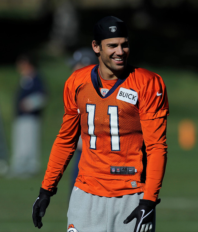 . Denver Broncos Eric Decker smiles as he stretches before practice on October 30, 2013 at Dove Valley. The players wore a different jersey number for their practices for Halloween. (Photo by John Leyba/The Denver Post)
