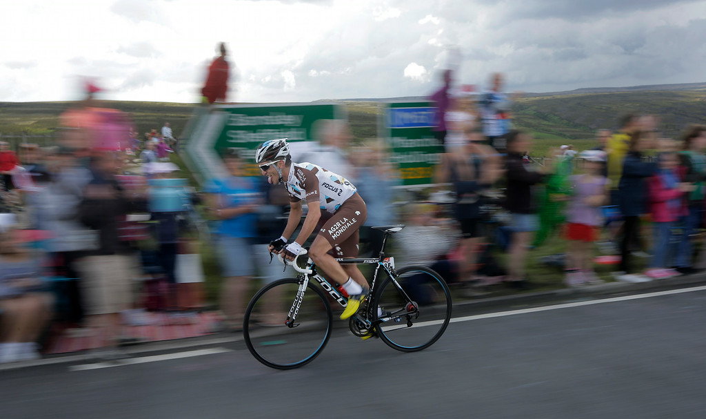 . France\'s Blel Kadri grimaces as he rides breakaway during the second stage of the Tour de France cycling race over 201 kilometers (124.9 miles) with start in York and finish in Sheffield, England, Sunday, July 6, 2014. (AP Photo/Laurent Cipriani)