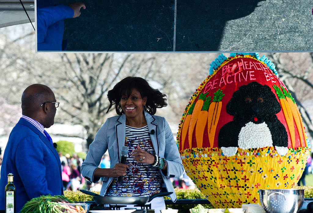 . US First Lady Michelle Obama arrives at a cooking station during the annual White House Easter Egg Roll in Washington on April 1, 2013.   AFP PHOTO/Nicholas KAMM/AFP/Getty Images