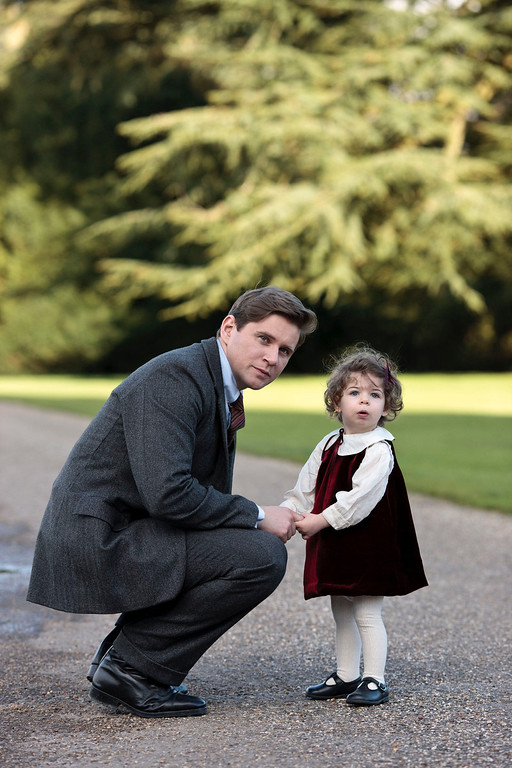 """. Branson and Sybil. The fourth season of \""""Downton Abbey\"""", set in 1922, sees the return of our much loved characters. As they face new challenges, the Crawley family and the servants who work for them remain inseparably interlinked.   (Photo by Nick Briggs/Carnival Films & Television Limited 2013 for MASTERPIECE)"""