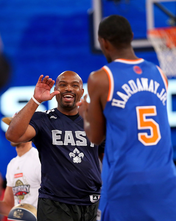 . NEW ORLEANS, LA - FEBRUARY 15: Eastern Conference All-Star Legend Tim Hardaway Sr. celebrates with Eastern Conference All-Star Tim Hardaway Jr. #5 of the New York Knicks during the Sears Shooting Stars Competition 2014 as part of the 2014 NBA All-Star Weekend at the Smoothie King Center on February 15, 2014 in New Orleans, Louisiana. (Photo by Ronald Martinez/Getty Images)