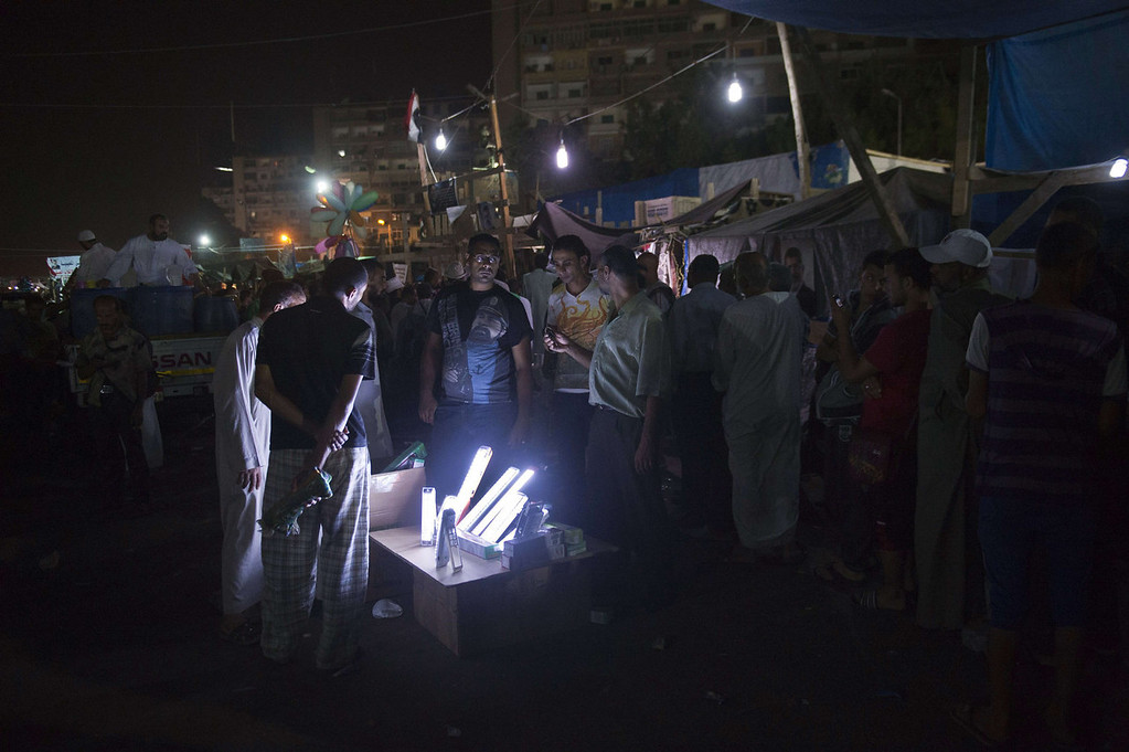 . Members of the Muslim Brotherhood and supporters of Egypt\'s ousted president Mohammed Morsi buy lighting items during a sit-in protest outside the Rabaa al-Adawiya mosque in Cairo on August 12, 2013. Egypt\'s judiciary extended ousted president Mohamed Morsi\'s detention as his supporters marched through Cairo in defiance of the expiry of a government ultimatum to dismantle their huge protest camps.   KHALED DESOUKI/AFP/Getty Images