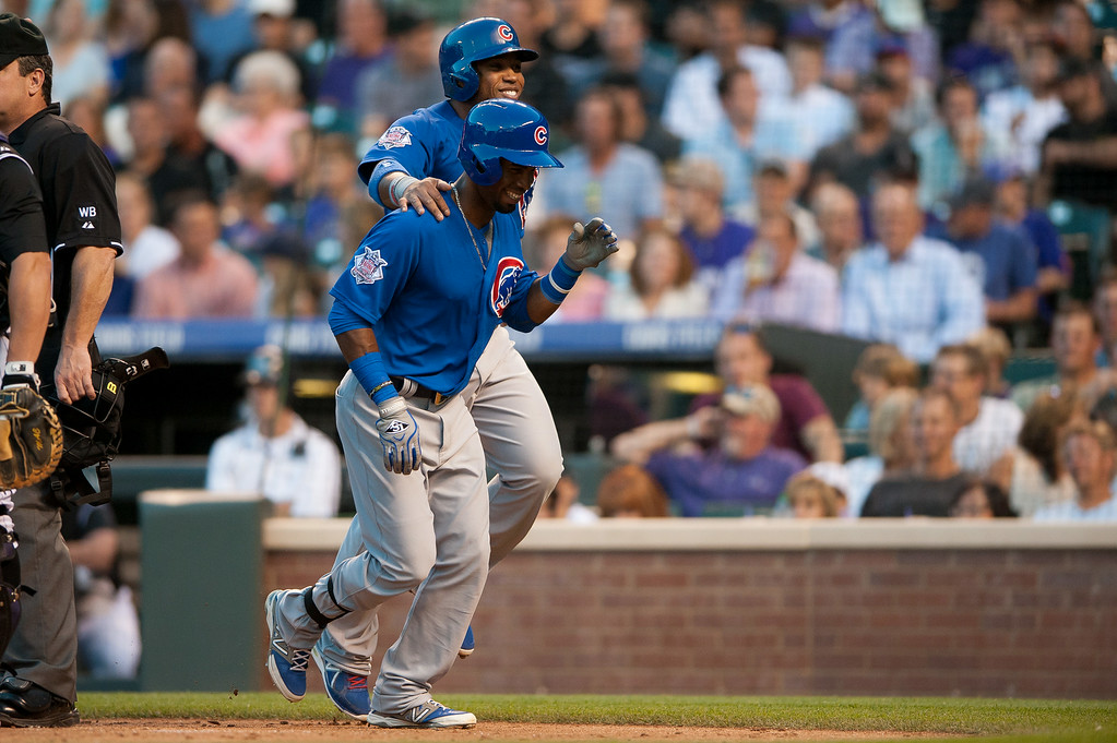 . DENVER, CO - AUGUST 06:  Arismendy Alcantara #7 and Luis Valbuena #24 of the Chicago Cubs celebrate a fourth inning Alcantara home run against the Colorado Rockies at Coors Field on August 6, 2014 in Denver, Colorado.  (Photo by Dustin Bradford/Getty Images)