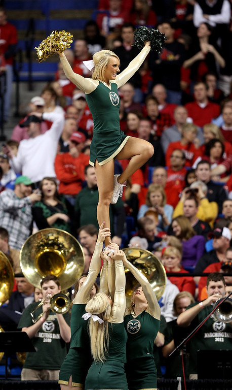 . LEXINGTON, KY - MARCH 23: The Colorado State Rams cheerleaders perform during a game stoppage in the first half against the Louisville Cardinals during the third round of the 2013 NCAA Men\'s Basketball Tournament at Rupp Arena on March 23, 2013 in Lexington, Kentucky.  (Photo by Andy Lyons/Getty Images)