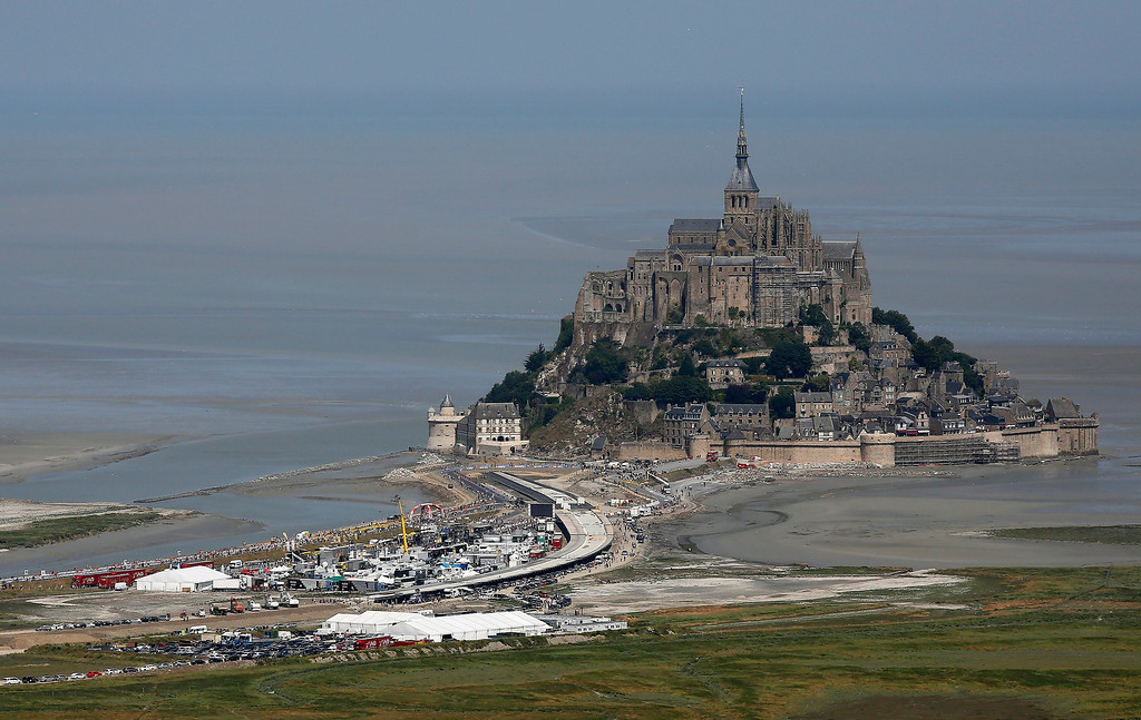 . Aerial view shows the Mont Saint-Michel during the 32 km individual time trial eleventh stage of the centenary Tour de France cycling race from Avranches to Mont-Saint-Michel July 10, 2013.  REUTERS/Yoan Valat/Pool