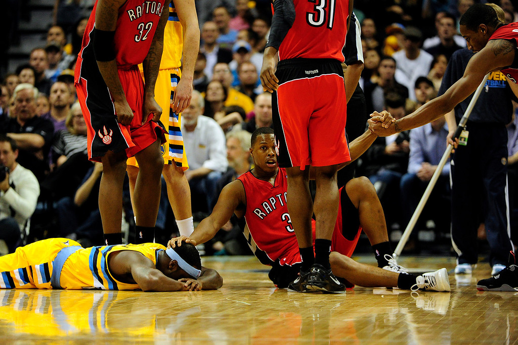 . Toronto Raptors point guard Kyle Lowry (3) rubs Denver Nuggets point guard Ty Lawson\'s (3) head after the two collided while vying for a loose ball during the second half of the Nuggets\' 113-110 win at the Pepsi Center on Monday, December 3, 2012. AAron Ontiveroz, The Denver Post
