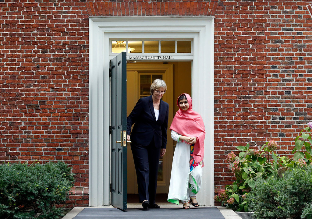 . Malala Yousafzai, right, leaves Massachusetts Hall with Harvard President Drew Gilpin Faust to a news conference on the school\'s campus in Cambridge, Mass. on Friday, Sept. 27, 2013. The Pakistani teenager, an advocate for education for girls, survived a Taliban assassination attempt last year on her way home from school. (AP Photo/Jessica Rinaldi)