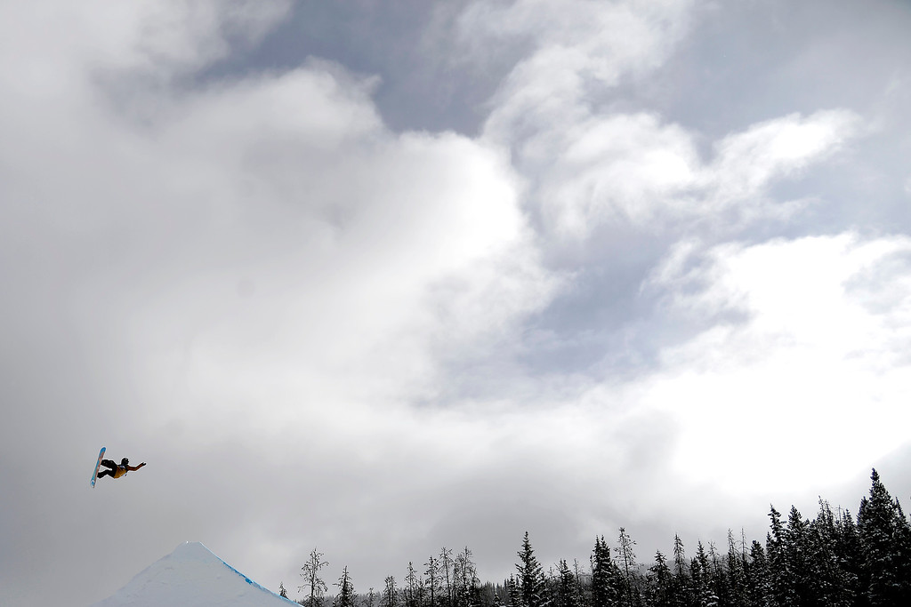 . Ryan Stassel rides during the slopestyle finals of the Copper Mountain Grand Prix. Riders competed in this stage of the FIS Snowboard World Cup 2014 on Sunday, December 22, 2013. (Photo by AAron Ontiveroz/The Denver Post)