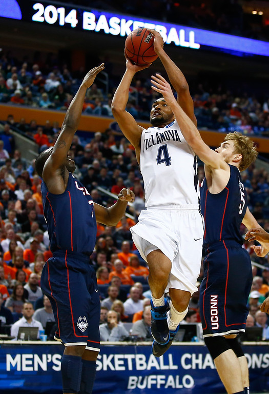 . BUFFALO, NY - MARCH 22: Darrun Hilliard II #4 of the Villanova Wildcats goes up for a shot as Niels Giffey #5 of the Connecticut Huskies defends during the third round of the 2014 NCAA Men\'s Basketball Tournament at the First Niagara Center on March 22, 2014 in Buffalo, New York.  (Photo by Jared Wickerham/Getty Images)