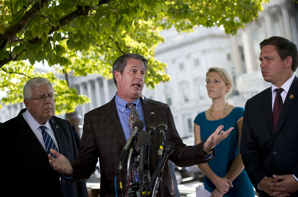 . US Senator David Vitter (C) speaks during a press conference on Capitol Hill in Washington, DC, September 30, 2013.  Senator Vitter penned an amendment to nix subsidies for the health care of congressional staffers.                          AFP PHOTO/Jim WATSON/AFP/Getty Images