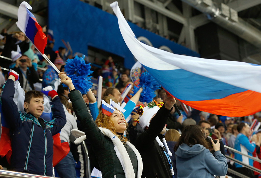 . A Russian fan celebrates a goal during the third period of the game against Germany at the 2014 Winter Olympics women\'s ice hockey game at Shayba Arena, Sunday, Feb. 9, 2014, in Sochi, Russia. (AP Photo/Petr David Josek)