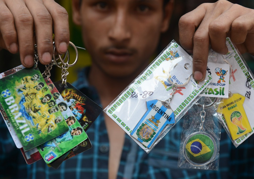 . An Indian shopkeeper displays key rings of football-playing countries taking part in the forthcoming FIFA World Cup 2014 in Brazil, at a shop in Siliguri on June 11, 2014. AFP PHOTO/ Diptendu DUTTA/AFP/Getty Images