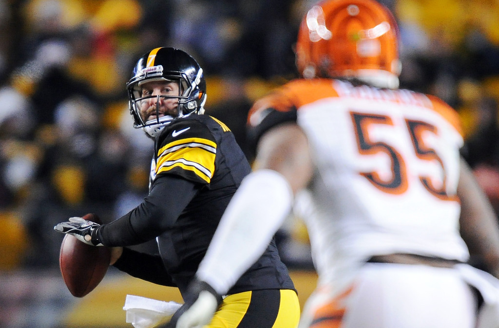 . Pittsburgh Steelers quarterback Ben Roethlisberger, left, looks to pass as Cincinnati Bengals outside linebacker Vontaze Burfict (55) defends in the third quarter an NFL football game on Sunday, Dec. 15, 2013, in Pittsburgh. (AP Photo/Don Wright)