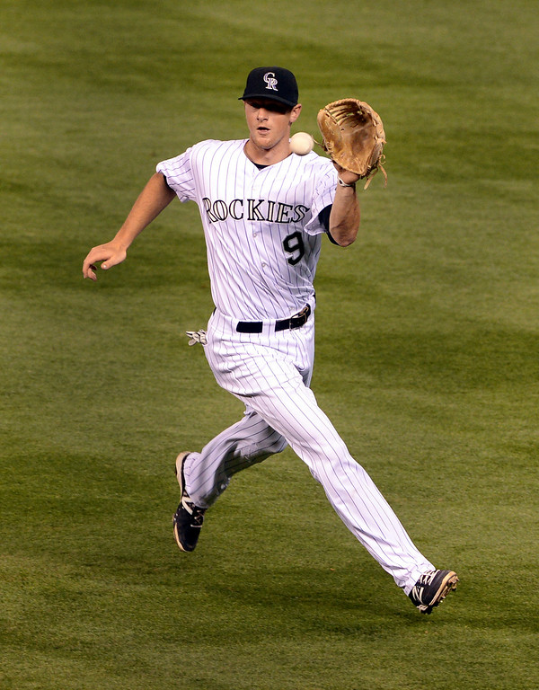 . DENVER, CO - APRIL 18: Colorado infielder DJ LeMahieu tracked down a ball off the bat of Philadelphia batter Tony Gwynn Jr. in the eighth inning. The Colorado Rockies defeated the Philadelphia Phillies 12-1 Friday night, April 18, 2014 at Coors Field.  (Photo by Karl Gehring/The Denver Post)