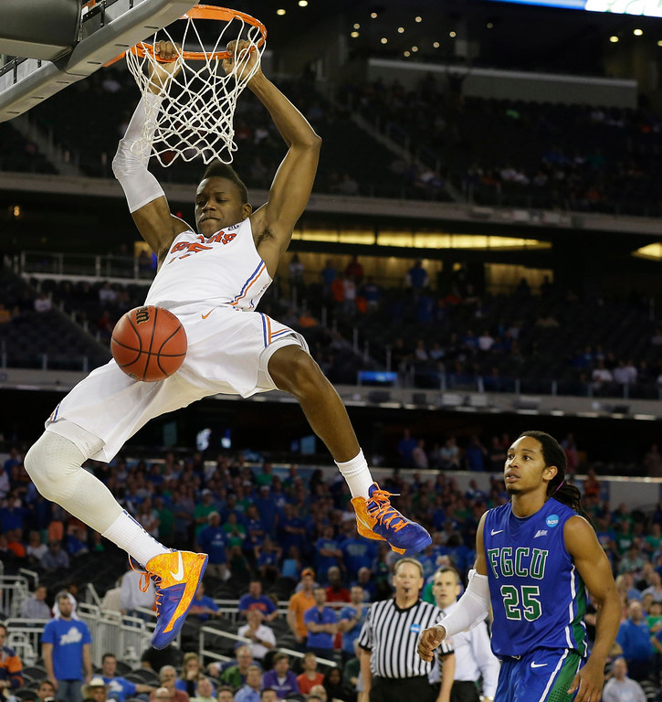 . Florida\'s Will Yeguete dunks against Florida Gulf Coast during the second half of a regional semifinal game in the NCAA college basketball tournament, Saturday, March 30, 2013, in Arlington, Texas. (AP Photo/Tony Gutierrez)