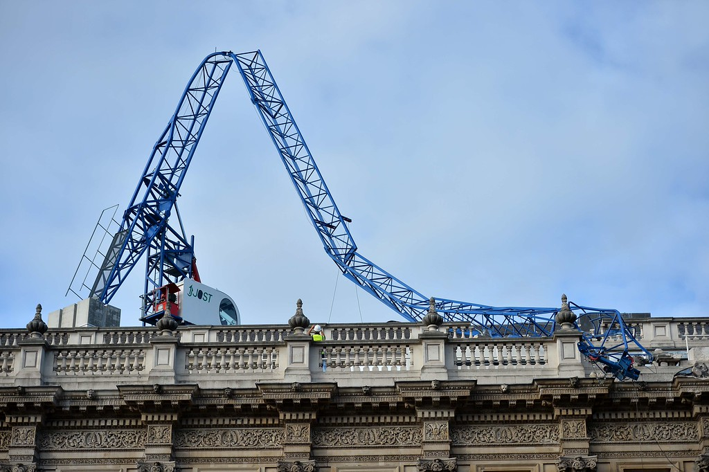 . A construction crane lays on top of the cabinet office government building after collapsing in high winds during a storm in central London on October 28, 2013.  AFP PHOTO / BEN  STANSALL/AFP/Getty Images