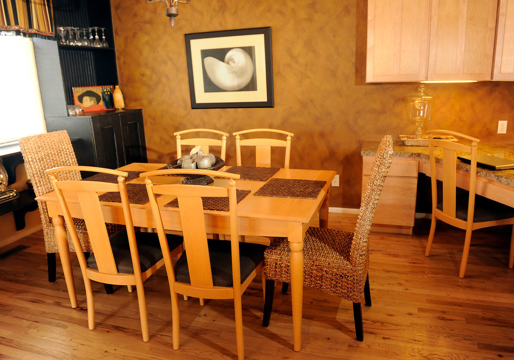 . The Lane dining-room set got a quick face-lift with re-upholstered seats (the fabric was $9.99).  (Photo By Cyrus McCrimmon/The Denver Post)