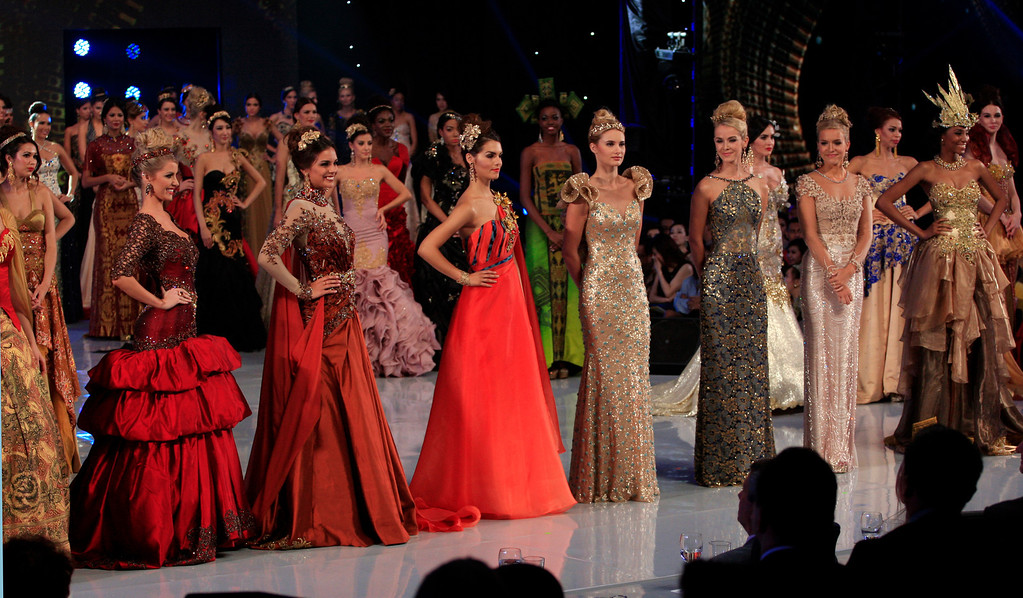 . Miss World contestants front row from left, Miss Brazil Sancler Frantz Konzen, Miss France Marine Lorphelin, Miss Cyprus Kristy Marine Agapioy, Miss Italy Sarah Bardena, Miss United States Olivia Jordan, Miss England Kristy Heslewood and Miss Cameroon Denies Valerie Ayena during the Miss World Fashion Show and Top Model competition at Bali International Convention Center in Nusa Dua, Bali, Indonesia, Tuesday, Sept. 24, 2013. The Miss World pageant final will be held in Bali on Sept. 28. (AP Photo/Firdia Lisnawati)