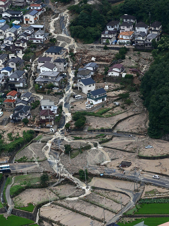 . This aerial view shows the damage caused by a landslide after heavy rains hit the city of Hiroshima, western Japan, on August 20, 2014. AFP PHOTO/Jiji PressJIJI PRESS/AFP/Getty Images