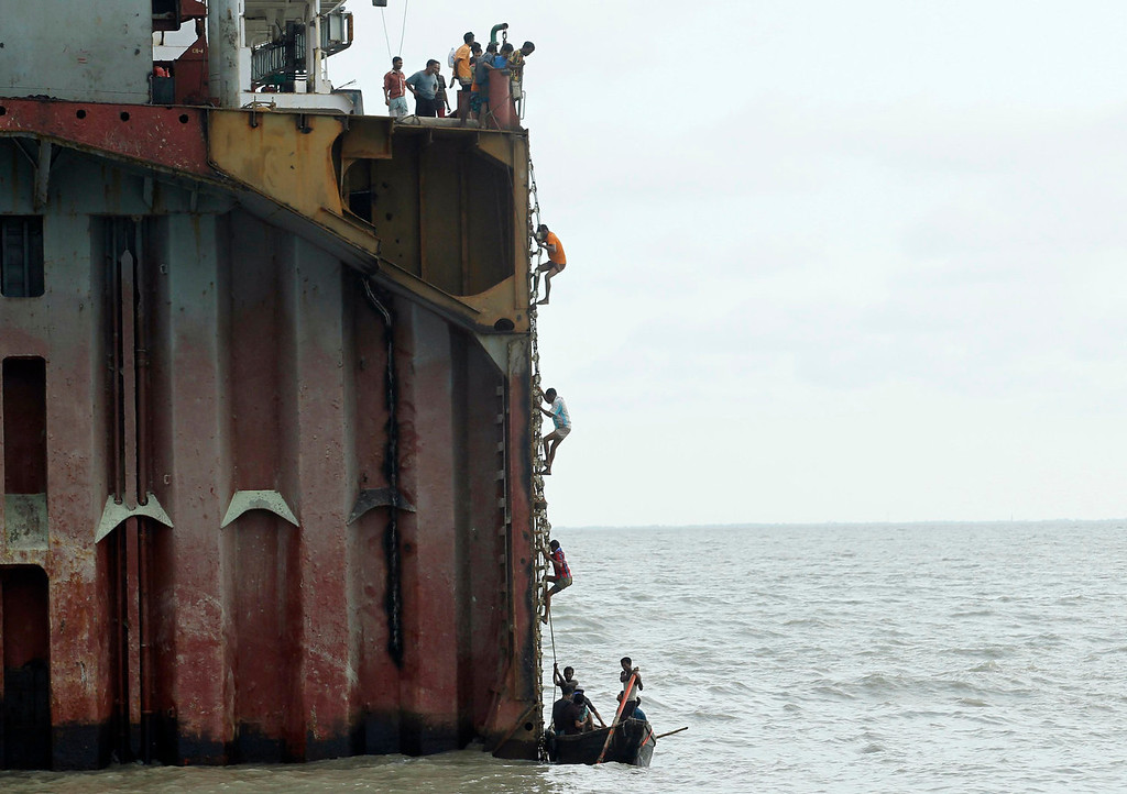 . Workers use a makeshift ladder to board a boat as they come back to shore after finishing work at a ship-breaking yard in Chittagong, Bangladesh July 16, 2013. Bangladesh is dependent on ship-breaking for its domestic steel requirements. According to a report by the Bangladesh Institute of Labour Studies, around 30,000 workers are employed in the ship-breaking industry in Chittagong, a highly polluted coastal belt of around 20 km (12.4 miles), and environmental organizations have said that the number of accidents and casualties at the yard is believed to be the highest in the region. International attention has been focused on workers\' safety in Bangladesh since the disaster at Rana Plaza, a garment factory complex which collapsed in April, killing 1,132 workers.   REUTERS/Andrew Biraj
