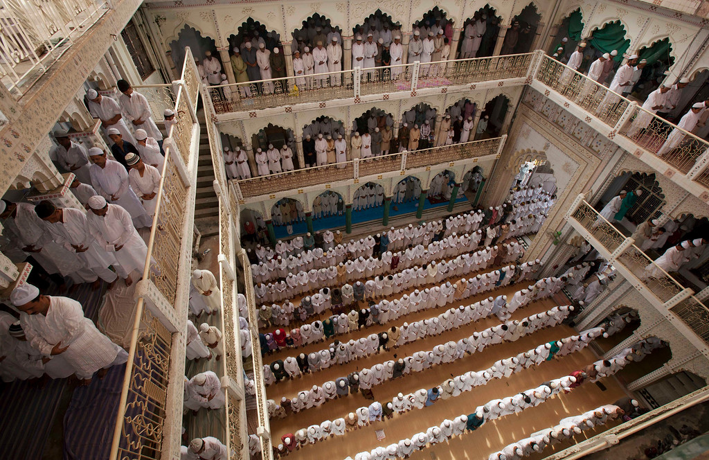 . Indian Muslims pray at the Vasi Ullah mosque in Allahabad, India, Friday, Aug. 9, 2013. Eid al-Fitr marks the end of the holy month of Ramadan, during which Muslims all over the world fast from sunrise to sunset. (AP Photo/Rajesh Kumar Singh)