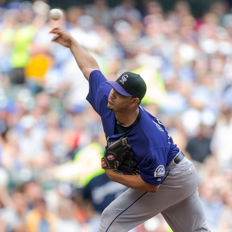 . Jhoulys Chacin of the Colorado Rockies pitches to a Milwaukee Brewers batter during the first inning of a baseball game Saturday, June 28, 2014, in Milwaukee. (AP Photo/Tom Lynn)
