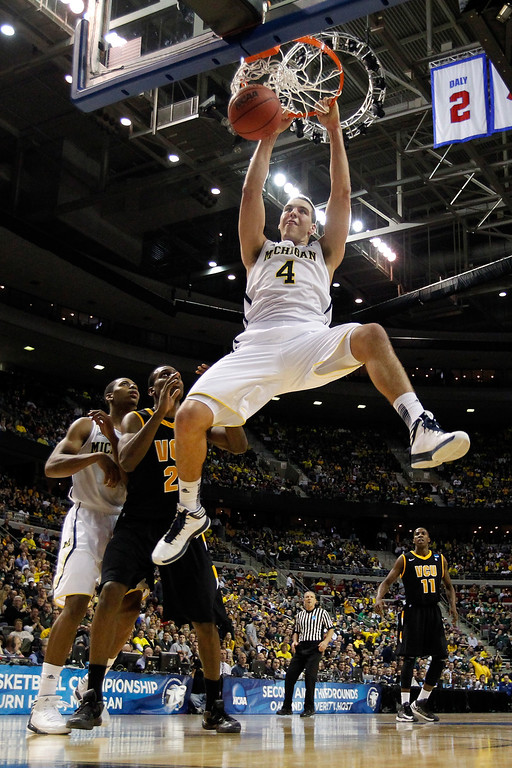 . AUBURN HILLS, MI - MARCH 23:  Mitch McGary #4 of the Michigan Wolverines duns against the Virginia Commonwealth Rams during the third round of the 2013 NCAA Men\'s Basketball Tournament at The Palace of Auburn Hills on March 23, 2013 in Auburn Hills, Michigan.  (Photo by Gregory Shamus/Getty Images)