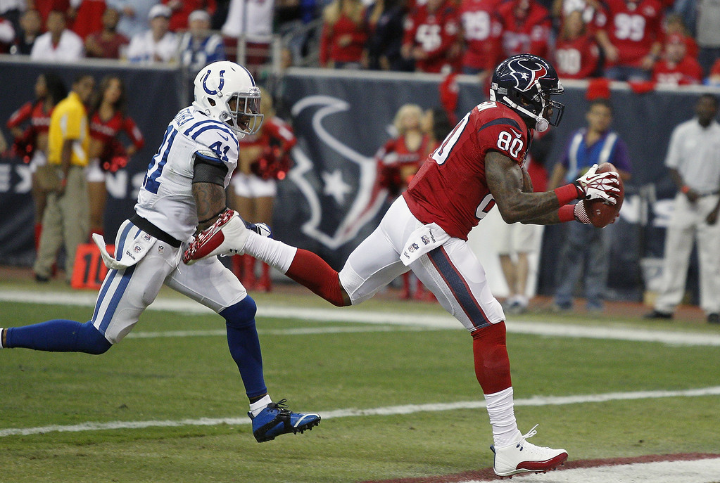 . Andre Johnson #80 of the Houston Texans catches a 41 yard pass for a touchdown in the first quarter as he gets behind Antoine Bethea #41 of the Indianapolis Colts at Reliant Stadium on November 3, 2013 in Houston, Texas. (Photo by Bob Levey/Getty Images)