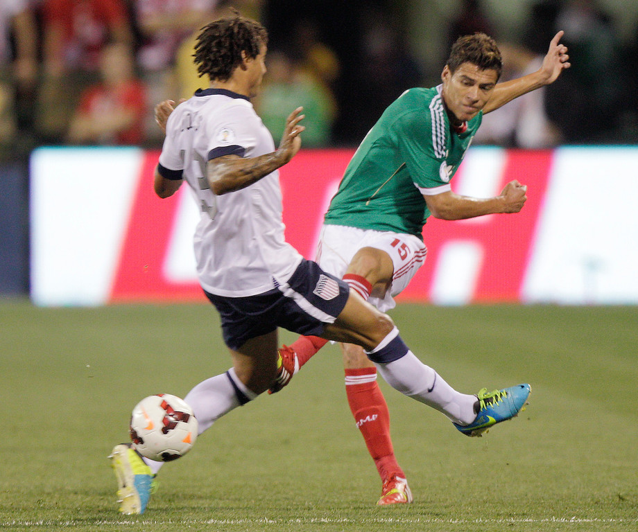 . Mexico\'s Hector Moreno, right, shoots the ball past the United States\' Jermaine Jones during the first half of a World Cup qualifying soccer match Tuesday, Sept. 10, 2013, in Columbus, Ohio. (AP Photo/Jay LaPrete)