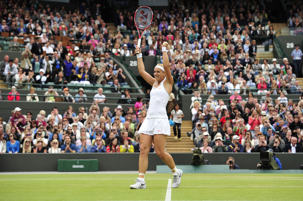 . Germany\'s Sabine Lisicki celebrates beating Estonia\'s Kaia Kanepi during their women\'s singles quarter-final match on day eight of the 2013 Wimbledon Championships tennis tournament at the All England Club in Wimbledon, southwest London, on July 2, 2013. Lisicki won 6-3, 6-3. GLYN KIRK/AFP/Getty Images