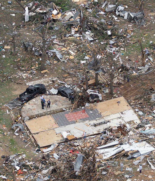 . A cleared home foundation stands out among the rubble in Granbury, Texas on Thursday, May 16, 2013.   (AP Photo/Star-Telegram,Ron T. Ennis)