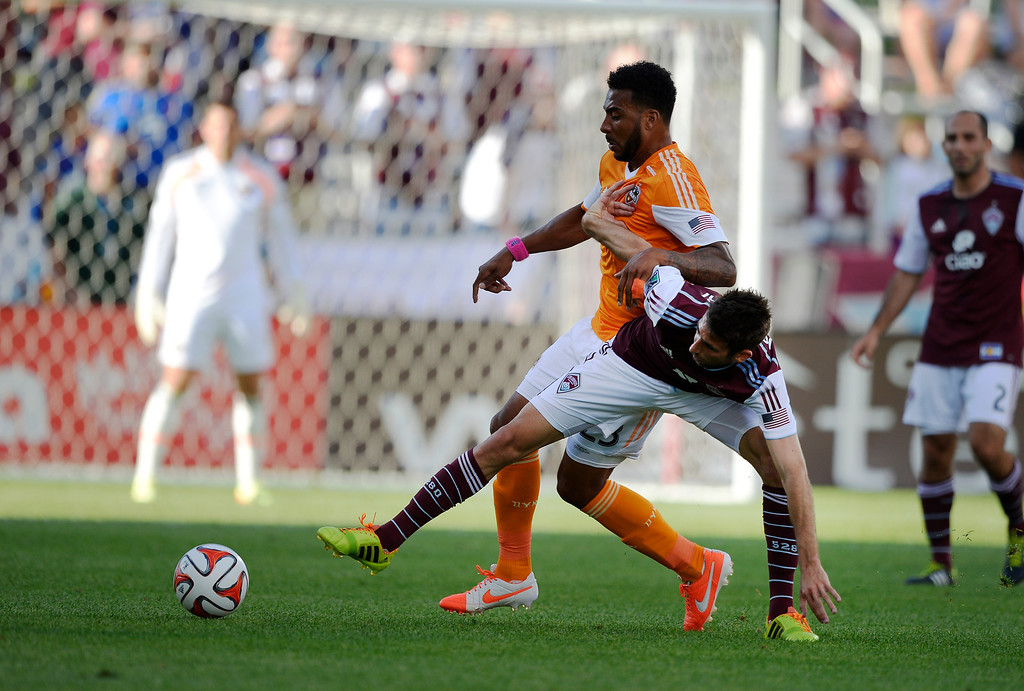 . Colorado Rapids midfielder Jose Mari (6) battle for the ball with Houston Dynamo midfielder Giles Barnes (23) during the first half June 1, 2014 at Dick\'s Sporting Goods Park. (Photo by John Leyba/The Denver Post)