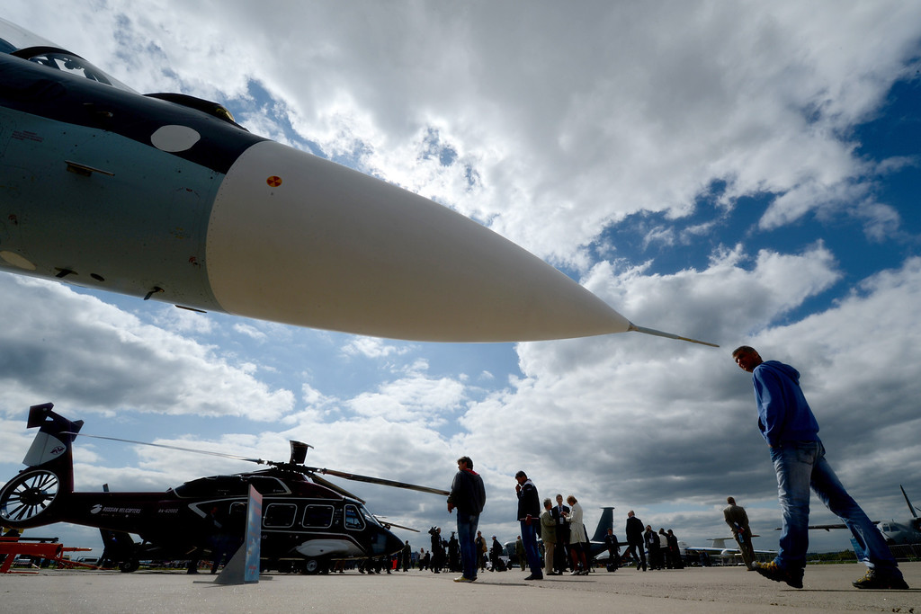 . Visitors look at military aircrafts during the International Aviation and Space Show MAKS-2013 on August 27, 2013 in Zhukovsky, outside Moscow. AFP PHOTO/KIRILL  KUDRYAVTSEV/AFP/Getty Images