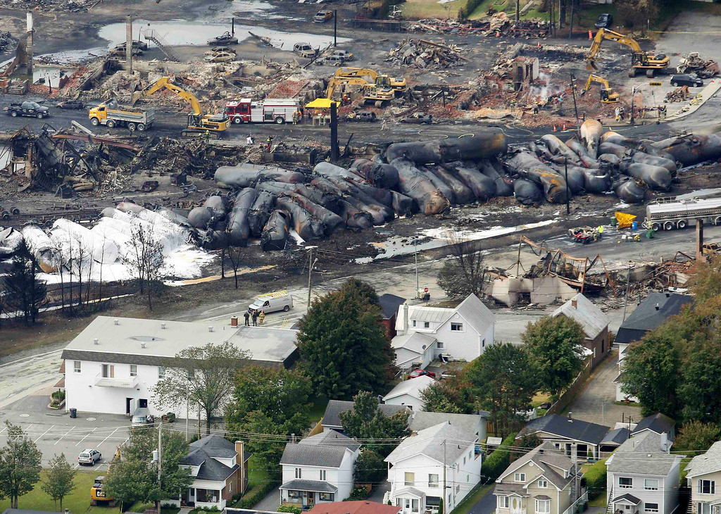 . Workers and firefighters work on the remains of downtown Lac Megantic, July 8, 2013.  REUTERS/Mathieu Belanger