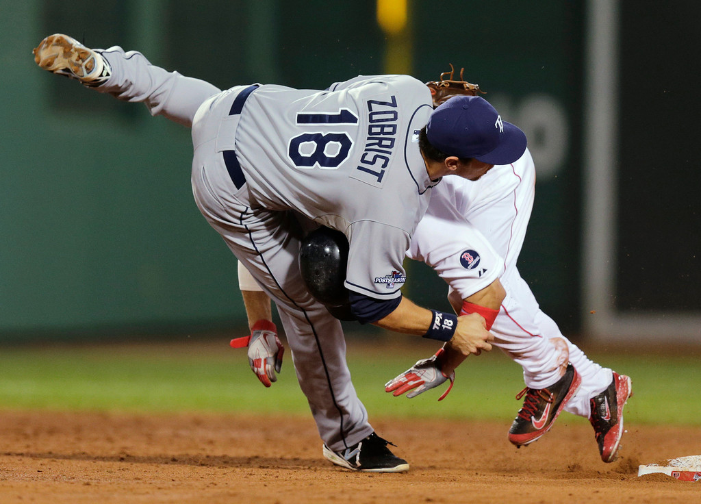 . Boston Red Sox\'s Shane Victorino rear, collides with Tampa Bay Rays second baseman Ben Zobrist (18) on a double-play attempt in the third inning of Game 2 of baseball\'s American League division series Saturday, Oct. 5, 2013, in Boston. Dustin Pedroia was safe at first. (AP Photo/Charles Krupa)