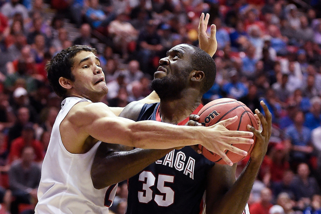 . Gonzaga center Sam Dower, right, can\'t reach the basket as he is guarded by Arizona guard Elliott Pitts during the first half of a third-round game in the NCAA college basketball tournament Sunday, March 23, 2014, in San Diego. (AP Photo/Denis Poroy)