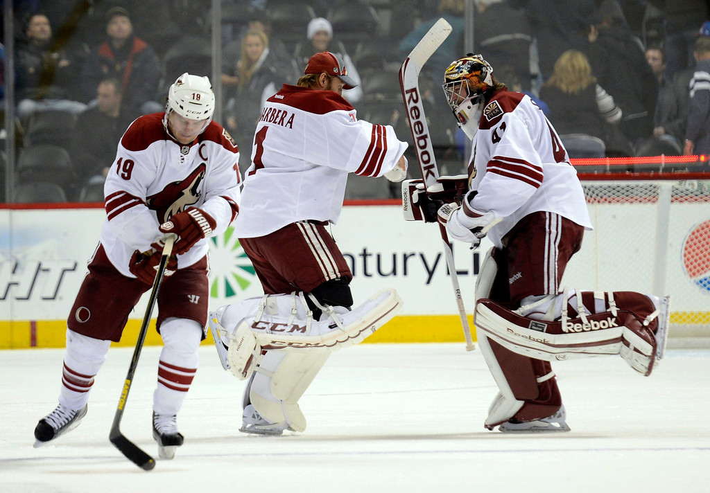. DENVER, CO. - FEBRUARY 11: Jason LaBarbera (1) of the Phoenix Coyotes and  Mike SmithShane do a victory dance as Doan (19) of the Phoenix Coyotes skates off the ice after his game-winning goal with 1:00 left in the overtime to defeat the Colorado Avalanche 3-2 February 11, 2013 at Pepsi Center. (Photo By John Leyba/The Denver Post)
