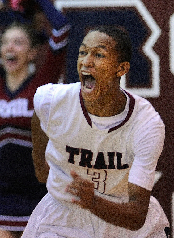 . Cougars senior guard Solmon Yon (3) reacted after putting in a rebound to win the game in the last second. The Cherokee Trail boy\'s basketball team defeated Overland 59-57 Friday night, January 11, 2013. Karl Gehring/The Denver Post
