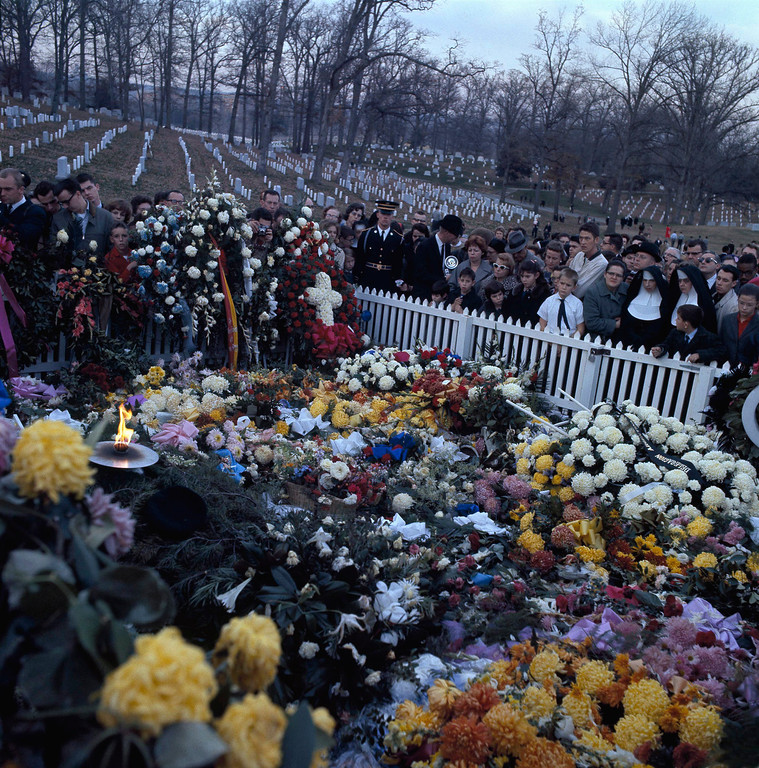 . Mourners gather at Kennedy\'s flower-bedecked grave Arlington National Cemetery on Nov. 27, 1963.   Associated Press file