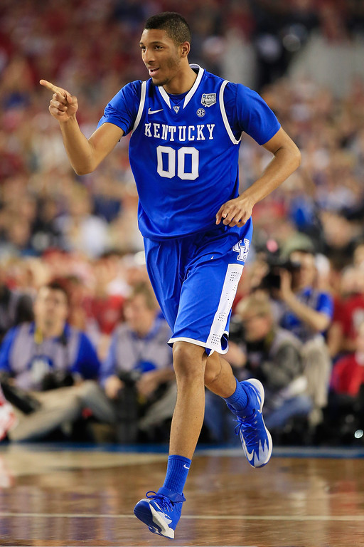 . ARLINGTON, TX - APRIL 05:  Marcus Lee #00 of the Kentucky Wildcats gestrues during the NCAA Men\'s Final Four Semifinal against the Wisconsin Badgers at AT&T Stadium on April 5, 2014 in Arlington, Texas.  (Photo by Jamie Squire/Getty Images)
