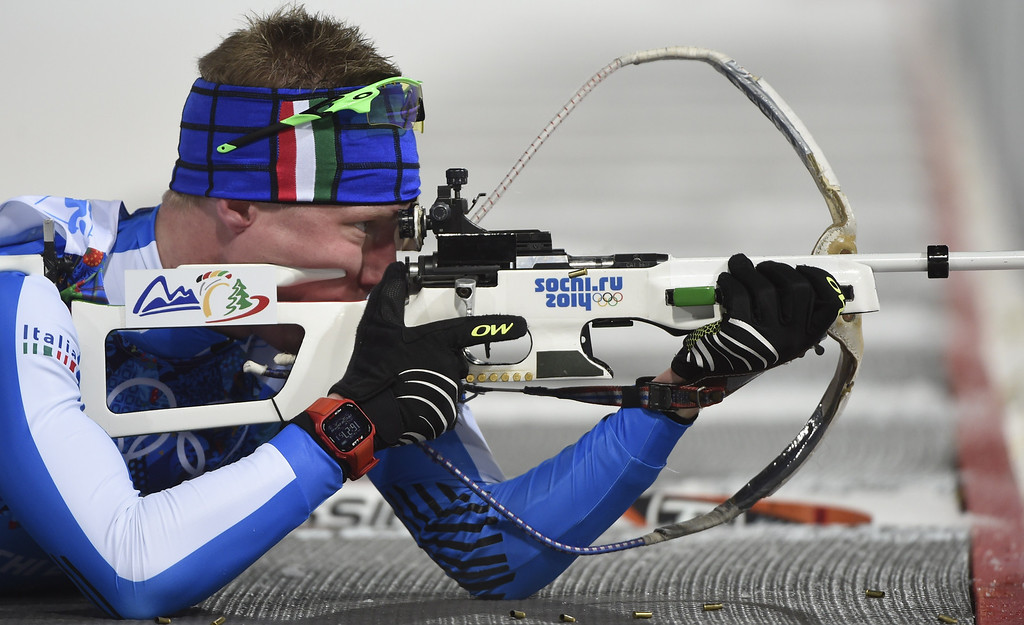 . Italy\'s Lukas Hofer competes to win bronze in the Biathlon mixed 2x6 km + 2x7,5 km Relay at the Laura Cross-Country Ski and Biathlon Center during the Sochi Winter Olympics on February 19, 2014 in Rosa Khutor near Sochi. AFP PHOTO / ODD ANDERSEN/AFP/Getty Images