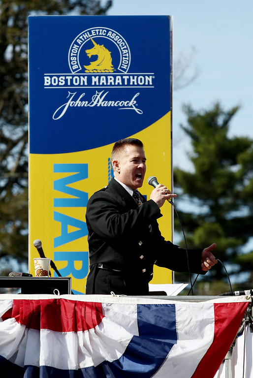 . Sgt. Daniel M. Clark sings the national anthem prior to the start of the 118th Boston Marathon on April 21, 2014 in Hopkinton, Massachusetts.  (Photo by Alex Trautwig/Getty Images)