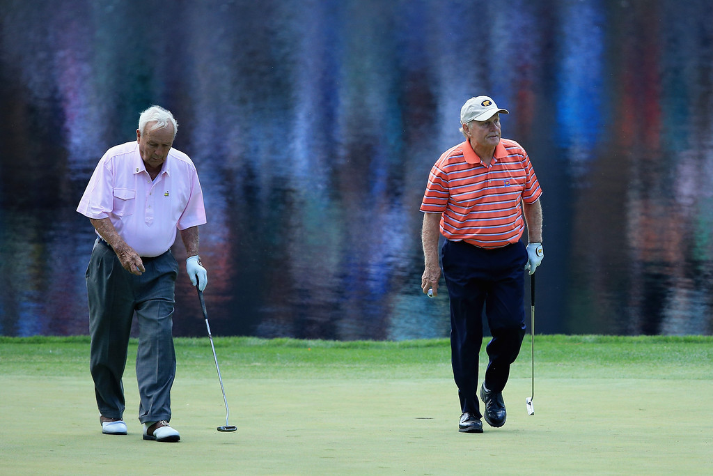 . Jack Nicklaus (R) and Arnold Palmer walk on the green during the 2014 Par 3 Contest prior to the start of the 2014 Masters Tournament at Augusta National Golf Club on April 9, 2014 in Augusta, Georgia.  (Photo by David Cannon/Getty Images)